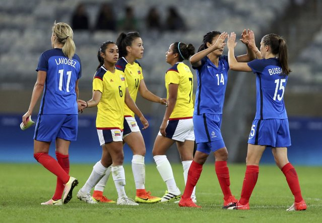 2016 Rio Olympics, Soccer, Preliminary, Women's First Round, Group G France vs Colombia, Mineirao, Belo Horizonte, Brazil on August 3, 2016. France's players and Colombia's players after the match. (Photo by Mariana Bazo/Reuters)