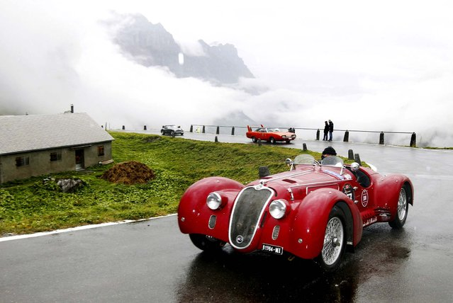 """Vintage cars attend the prologue of the traditional """"Klausenrennen"""" car race at the Klausenpass between Glarus and Altdorf, Switzerland, on September 29, 2012. (Photo by Urs Flueeler/Keystone)"""