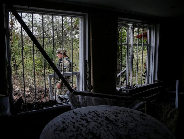 Ukrainian serviceman is seen at his position on the front line near Avdeyevka, Ukraine, August 12, 2016. (Photo by Gleb Garanich/Reuters)
