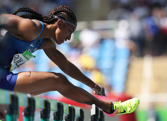 United States' Brianna Rollins competes in a women's 100-meter hurdles heat during the athletics competitions of the 2016 Summer Olympics at the Olympic stadium in Rio de Janeiro, Brazil, Tuesday, Aug. 16, 2016. (AP Photo/Lee Jin-man)