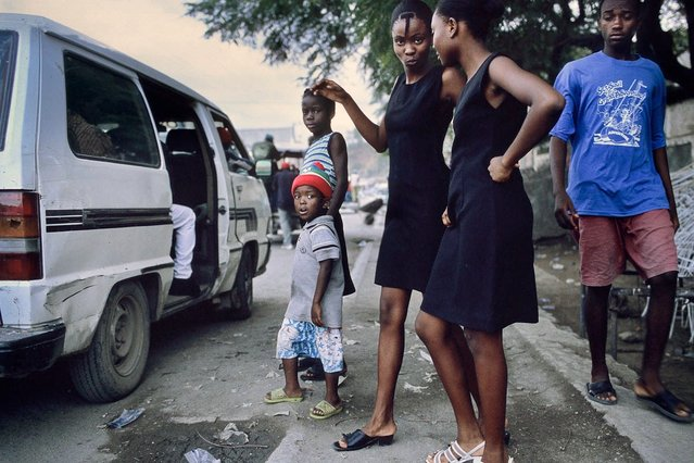 Cap-Haitien, Haiti. Two girls returning from a funeral in October 2003. (Photo by Jean-Claude Coutausse)