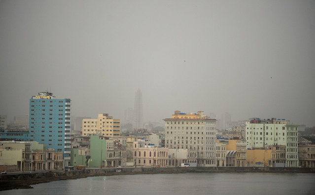 View of Havana covered by a cloud of dust on June 25, 2020. A massive cloud of Saharan dust darkened much of Cuba on Wednesday and began to affect air quality in Florida, sparking warnings to people with respiratory illnesses to stay home. (Photo by Yamil Lage/AFP Photo)