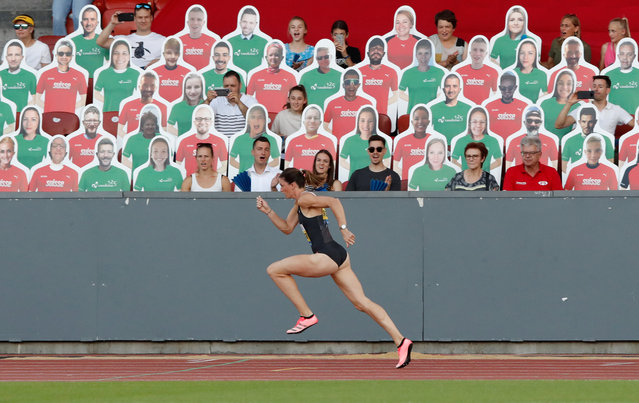 Switzerland's Lea Sprunger in action during the 300m hurdles race during the Weltklasse Zurich Inspiration Games, a virtual international athletics meeting with 30 athletes in eight disciplines at seven venues worldwide, in the Letzigrund stadium in Zurich, Switzerland, Thursday, July 9, 2020. (Photo by Arnd Wiegmann/Reuters)