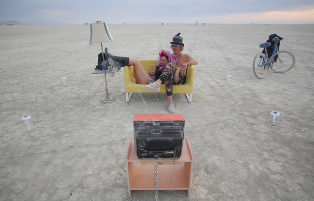 Jody Friedman and Jeff Montgomery infront of the Playa TV as approximately 70,000 people from all over the world gather for the 30th annual Burning Man arts and music festival in the Black Rock Desert of Nevada, U.S. August 30, 2016. (Photo by Jim Urquhart/Reuters)