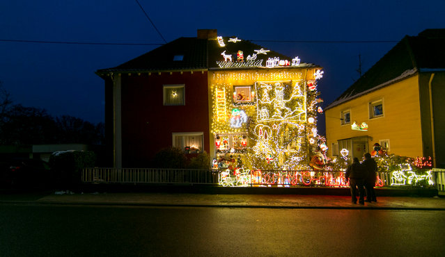 The private home of Sven Berrar and Sven Schaan is illuminated with around 67,000 lamps in Voelklingen, Germany, 04 December 2017. The house shines brightly every evening from 05pm to 10pm. On Advent weekends, up to 250 people come to look at the as Christmas House. (Photo by Thomas Wieck/EPA/EFE)