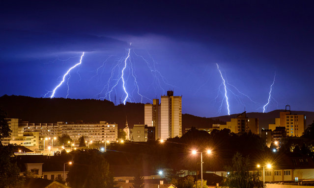 A lightning strikes across the sky above the town of Salgotarjan, Hungary, late Tuesday, 13 August 2019. (Photo by Péter Komka/EPA/EFE)