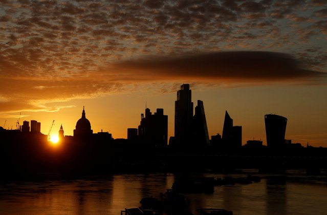 The sun rises behind the skyline of St Paul's Cathedral and the City of London, in London, Britain, August 2, 2020. (Photo by John Sibley/Reuters)