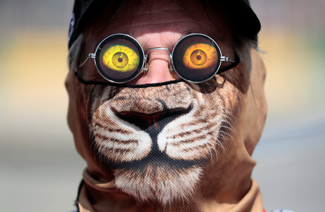 Formula One, Australian Grand Prix in Melbourne, Australia on March 24, 2017. Race official Graham Warren wears a cat mask and 3D sunglasses trackside during the first Formula One practice session. (Photo by Jason Reed/Reuters)
