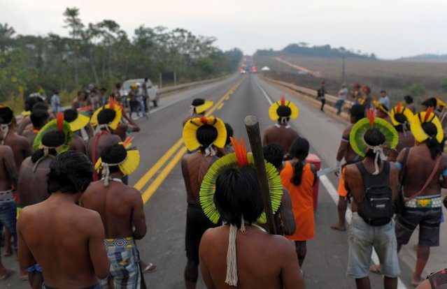 Kayapo indigenous people block Brazil's BR 163 national highway, as they protest against the government measures in the indigenous lands to avoid the spread of the coronavirus disease (COVID-19), in Novo Progresso, Para state, Brazil August 18, 2020. (Photo by Lucas Landau/Reuters)