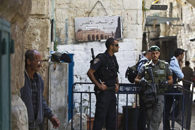 Israeli policemen stand guard at an entrance to Al-Aqsa mosque, on a compound known by Muslims as the Noble Sanctuary and by Jews as the Temple Mount, in Jerusalem's Old City October 8, 2015. (Photo by Ronen Zvulun/Reuters)