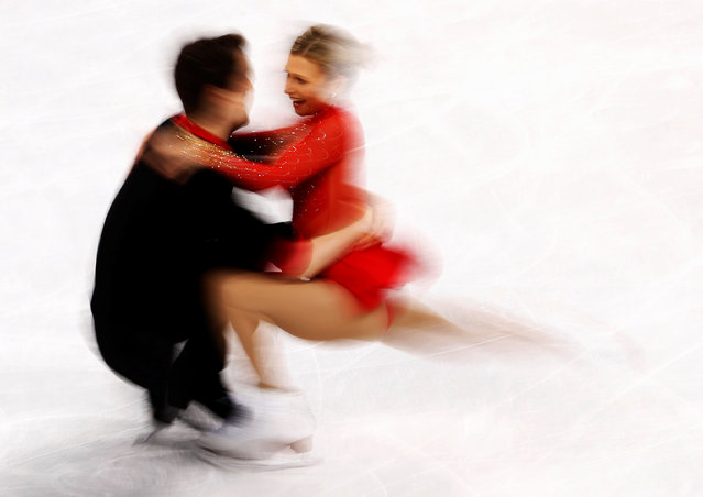 Canada' s Kirsten Moore- Towers and Canada' s Michael Marinaro compete in the pair skating short program of the figure skating event during the Pyeongchang 2018 Winter Olympic Games at the Gangneung Ice Arena in Gangneung on February 14, 2018. (Photo by Damir Sagolj/Reuters)