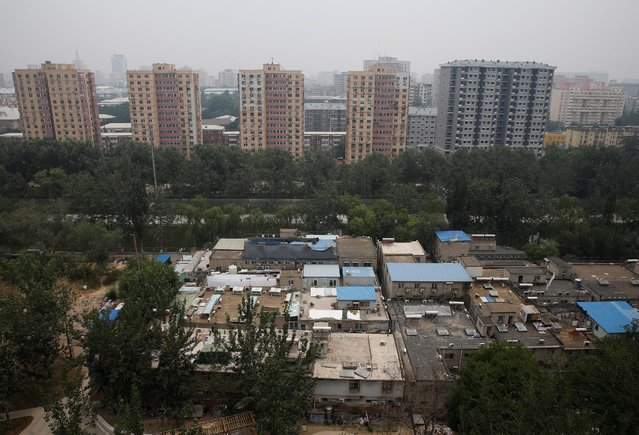 A cluster of buildings (front) where some patients and their family members stay while seeking medical treatments is seen in Beijing, China, June 23, 2016. (Photo by Kim Kyung-Hoon/Reuters)
