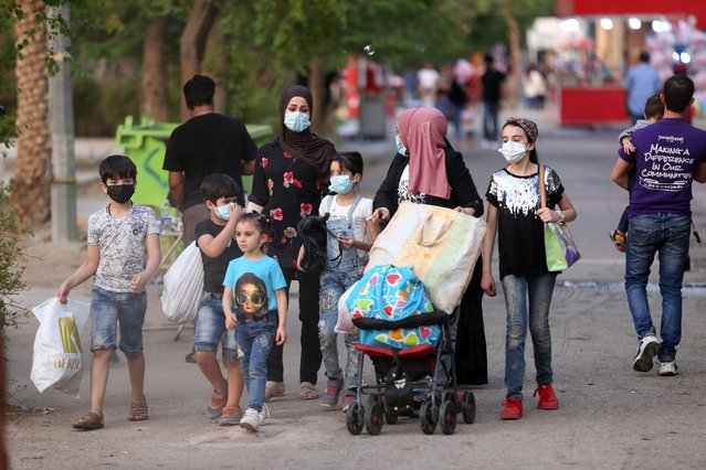 Citizens are seen at a park after parks re-opened to visitors following the closure as part of the easing restrictions within the novel coronavirus (COVID-19) pandemic in Bagdad, Iraq on September 26, 2020. (Photo by Murtadha Al-Sudani/Anadolu Agency via Getty Images)