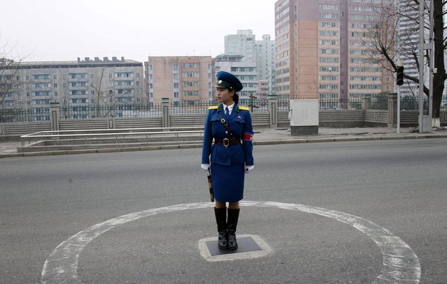 A North Korean traffic coordinator stands on duty in Pyongyang, on April 10, 2012. (Photo by Ng Han Guan/AP Photo)