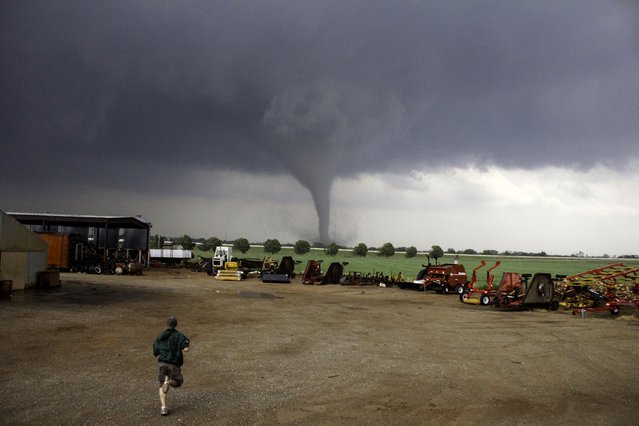 Mike running toward the tornado in Chickasha, Oklahoma on May 2011. (Photo by Mike Mezeul II/Caters News)