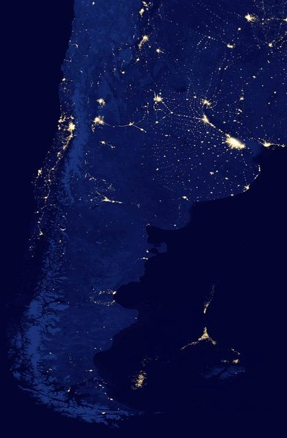 The southern tip of South America glitters at night in an image from the Suomi NPP satellite that was captured in April 2012 and made public on March 22, 2013. Off the coast, the lights of a huge fleet of shrimp boats can be seen, right along the maritime border that separates Argentina, the Falkland Islands and international waters. Scientists say this unmanaged fleet is threatening the South Atlantic marine ecosystem by depleting squid, which are key to a food chain that provides sustenance for penguins, seals, birds and whales. (Photo by NASA's Suomi Polar-orbiting Partnership via AP)