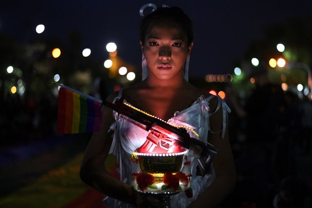 Transgender drag queen Aunchalee Pokinwuttipob, better known by the stage name, Angele Anang, 26, poses for a photograph during a rally against Prime Minister Prayuth Chan-ocha and to call for reforms to the monarchy, in Bangkok, Thailand, September 19, 2020. (Photo by Chalinee Thirasupa/Reuters)