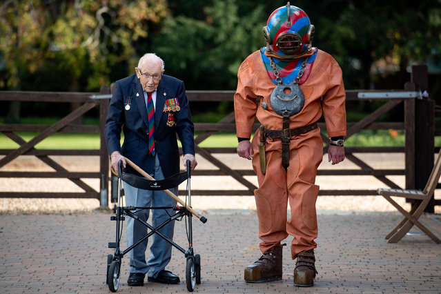 Captain Sir Tom Moore in Wootton, Marston Moretaine, Bedford with veteran fundraiser Lloyd Scott, who will attempt to climb the Three Peaks whilst wearing a deep sea diving suit on September 24, 2020. (Photo by Jacob King/PA Images via Getty Images)