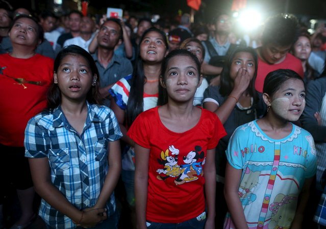 Supporters of Myanmar opposition leader Aung San Suu Kyi celebrate partial results shown on television outside NLD party headquarters in Yangon November 8, 2015. Voting unfolded smoothly in Myanmar on Sunday with no reports of violence to puncture a mood of jubilation marking the Southeast Asian nation's first free nationwide election in 25 years, its biggest stride yet in a journey to democracy from dictatorship. (Photo by Soe Zeya Tun/Reuters)