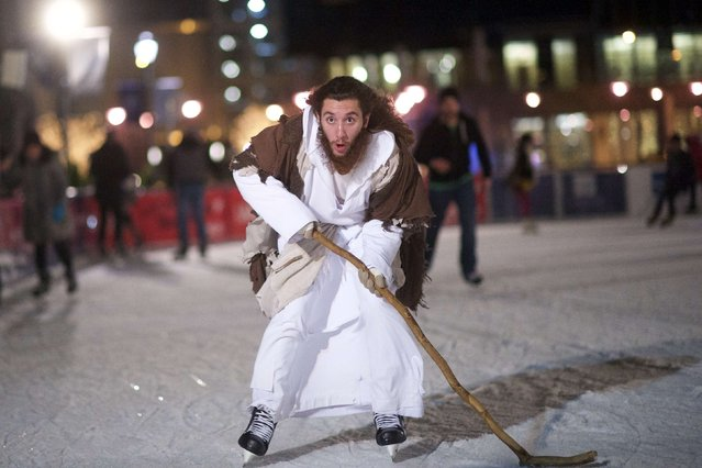 "Using his walking staff as a makeshift hockey stick, Michael Grant, 28, ""Philly Jesus"", skates at Rothman Ice Rink in Philadelphia, Pennsylvania December 14, 2014. (Photo by Mark Makela/Reuters)"