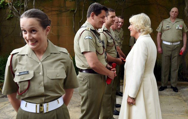 Private Alana Smilie (L) reacts alongside Britain's Camilla, Duchess of Cornwall, as she meets military police during a visit to the Royal Australian Corps of Military Police at the Victoria Barracks in Sydney, November 12, 2015. The Duchess of Cornwall is the Colonel-in-Chief of the Australian Army's Corps of Military Police. (Photo by William West/Reuters)