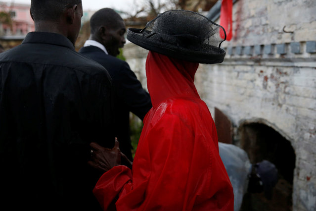 Relatives attend to the funeral of a woman who died during Hurricane Matthew in Jeremie, Haiti, October 17, 2016. (Photo by Carlos Garcia Rawlins/Reuters)