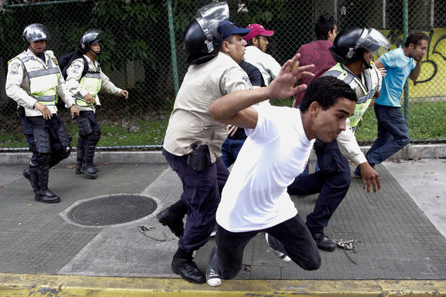 Demonstrators clash with riot police during a student rally demanding a referendum to remove Venezuela's President Nicolas Maduro in Caracas, Venezuela October 24, 2016. (Photo by Marco Bello/Reuters)