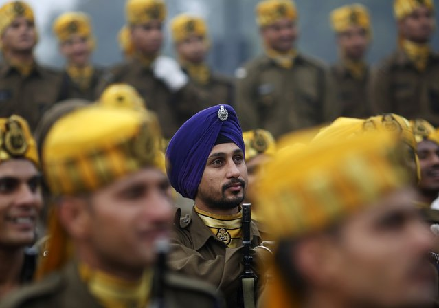 Indian soldiers listen to their instructor (not pictured) during the rehearsal for the Republic Day parade on a cold winter morning in New Delhi January 6, 2015. (Photo by Ahmad Masood/Reuters)