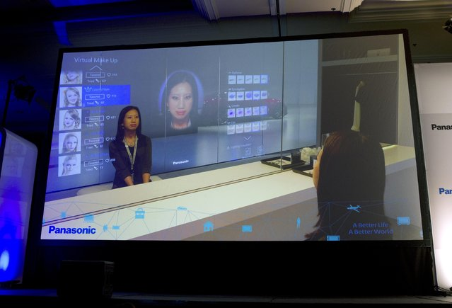 A display shows Panasonic's virtual make-up mirror at a Panasonic news conference during the 2015 International Consumer Electronics Show (CES) in Las Vegas, Nevada January 5, 2015. The technology will allow users to try out different looks without actually putting make-up on their face. (Photo by Steve Marcus/Reuters)