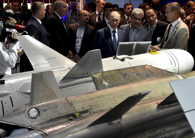 Vladimir Putin visits an exhibition at the MAKS International Aviation and Space Salon in Zhukovsky, outside Moscow, Russia, August 25, 2015. (Photo by Kirill Kudryavtsev/Reuters)
