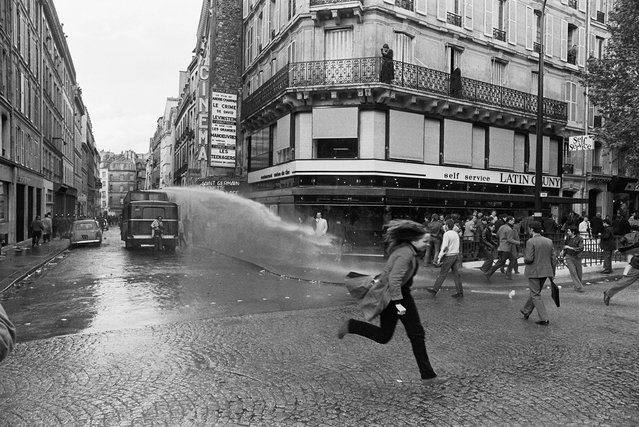 """The night of the barricades"" resulted in a violent conflict between CRS riot police and thousands of striking students. Numerous police and students were injured in the clash in the ""Mabillon"" area on Boulevard Saint Germain, Paris, France, May 6, 1968. (Photo by Gökşin Sipahioğlu/SIPA Press)"