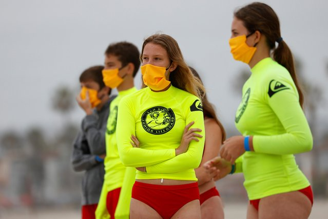 Participants on the beach wear masks as San Diego's Junior Lifeguard Program officially reopens with new protocols in place to comply with county health guidelines in San Diego, California, June 15, 2020. (Photo by Mike Blake/Reuters)