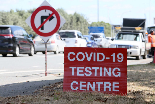 Signs direct drivers waiting for a COVID-19 testing at a pop-up testing centre at Marsden Point, New Zealand, on Monday, January 25, 2021. Health officials in New Zealand say genome tests indicate the country's most recent COVID-19 patient contracted the virus from another returning traveler just before leaving quarantine. (Photo by Tania Whyte/Northern Adivacate/NZME via AP Photo)