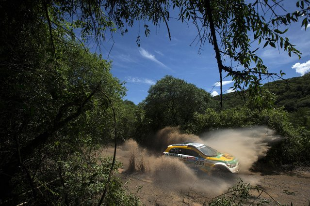 Mitsubishi driver Carlos Sousa and co-pilot Paulo Fiuza, both of Portugal, race in the eleventh stage of the Dakar Rally 2015 between the cities of Salta and Termas de Rio Hondo, Argentina, Thursday, January 15, 2015. The race returned to Argentina after passing through Bolivia and Chile and will finish on Jan. 17 in Buenos Aires. (Photo by Felipe Dana/AP Photo)