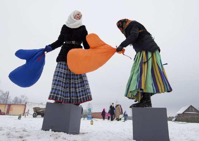 Women play as they take part in Kolyada holiday celebrations in the village of Martsiyanauka, east of the capital Minsk, January 21, 2015. (Photo by Vasily Fedosenko/Reuters)