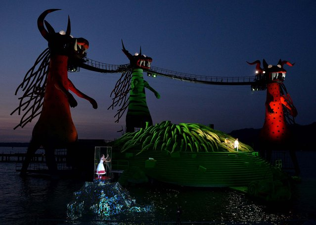 """Singers and artists perform on a giant futuristic stage built into Lake Constance in Bregenz, Austria, at a dress rehearsal of Wolfgang Amadeus Mozart's opera """"Die Zauberfloete"""" ( The Magic Flute), on July 12, 2013. (Photo by Kerstin Joensson/Associated Press)"""