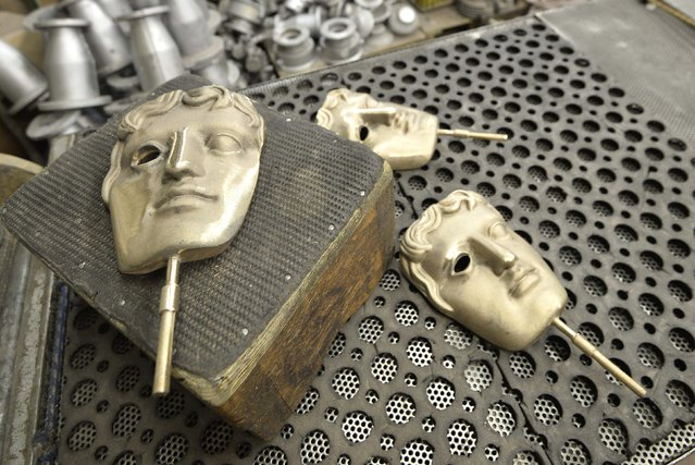 Partially completed British Academy of Film and Television Awards (BAFTA) bronze masks are seen at a foundry in west London, January 27, 2015. The masks are being cast and finished at the foundry ahead of the 2015 BAFTA Awards Ceremony which takes place in London on February 8. (Photo by Toby Melville/Reuters)