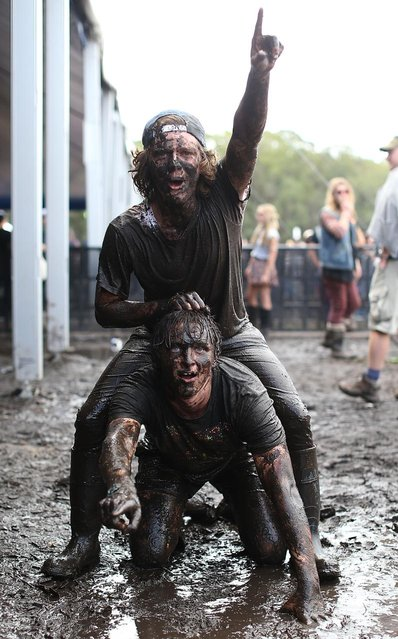 Festival goers bathe in mud on day 3 of the 2013 Splendour In The Grass Festival on July 28, 2013 in Byron Bay, Australia. (Photo by Mark Metcalfe/Getty Images)