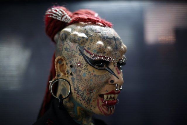 """Mexican body modification and tattoo artist Maria Jose Cristerna, also known as """"Vampire Woman"""", poses for a portrait at Caracas's International Tattoo Festival January 30, 2015. Local and international tattoo celebrities joined a host of aficionados from across Venezuela on Friday at the four-day festival, which aims to spread awareness of tattoo culture in Venezuela and promote tattooing as an art form. (Photo by Jorge Silva/Reuters)"""