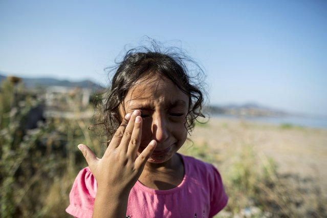 Yasmine, a 6-year-old migrant from Deir Al Zour in war-torn Syria, cries at the beach after arriving on the Greek island of Lesbos September 11, 2015. (Photo by Zohra Bensemra/Reuters)