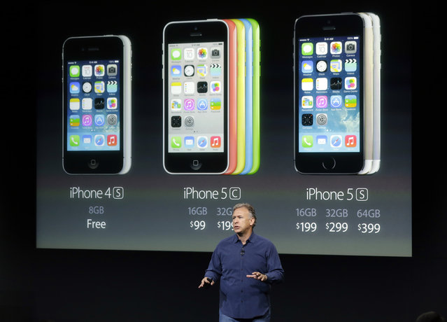 Phil Schiller, Apple's senior vice president of worldwide product marketing, speaks on stage during the introduction of the new iPhone 5c and 5s in Cupertino, Calif., Tuesday, September 10, 2013. (Photo by Marcio Jose Sanchez/AP Photo)