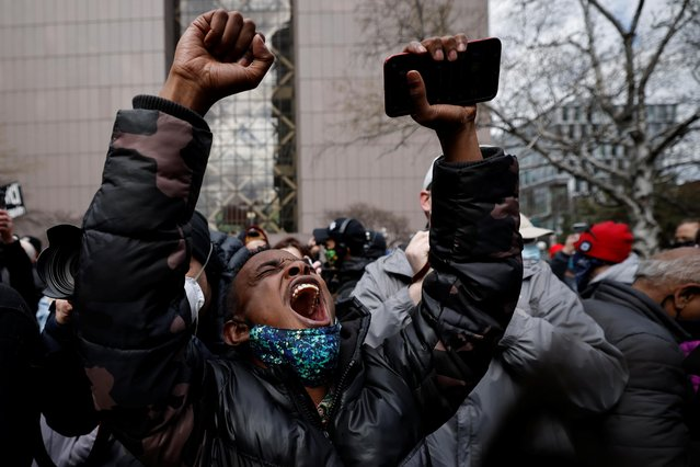 A person reacts after the verdict in the trial of former Minneapolis police officer Derek Chauvin, found guilty of the death of George Floyd, in front of Hennepin County Government Center, in Minneapolis, Minnesota, April 20, 2021. (Photo by Carlos Barria/Reuters)