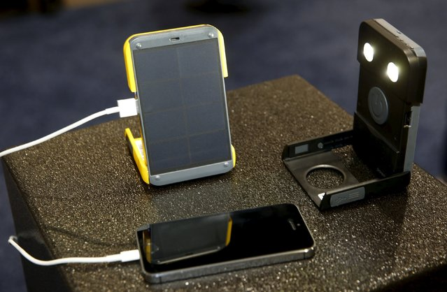 The WakaWaka Power+ compact solar charger and WakaWaka Light flashlight are displayed during the 2016 CES trade show in Las Vegas, Nevada January 8, 2016. Once the internal battery is charged, the $79.00 device charges a smartphone in less than 2 hours. The company also donates a solar-powered flashlight to someone without access to electricity for every unit sold, a representative said. (Photo by Steve Marcus/Reuters)