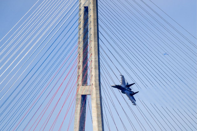 A Sukhoi Su-35S fighter jet of the Russian Eastern Military District performs a test flight over the Ajax Bay by Russky Island in Vladivostok, Russia on September 5, 2018 ahead of the 2018 Eastern Economic Forum to be held on September 11-13, 2018. (Photo by Yuri Smityuk/TASS)