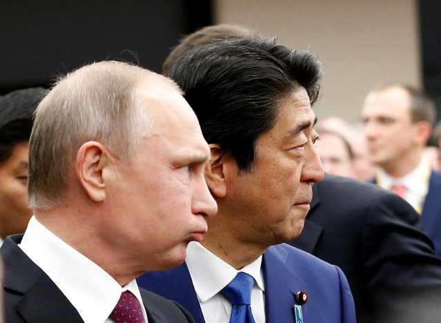 Russian President Vladimir Putin (L) and Japanese Prime Minister Shinzo Abe arrives at a Japanese-Russian business dialogue meeting in Tokyo, Japan, December 16, 2016. (Photo by Kim Kyung-Hoon/Reuters)