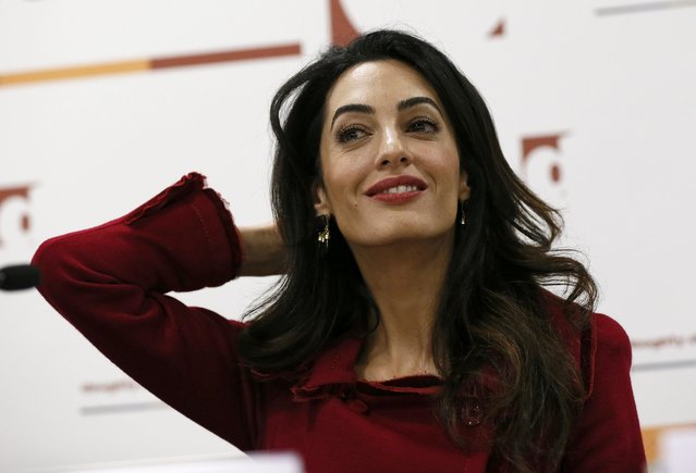 Lawyer Amal Clooney reacts during a news conference for Mohamed Nasheed, in central London, Britain January 25, 2016. Former president of the Maldives, Nasheed, freed from jail last week to seek medical care in Britain, called on Monday for sanctions against Maldivian government figures as his lawyer warned a militant attack on tourists was highly likely. (Photo by Stefan Wermuth/Reuters)