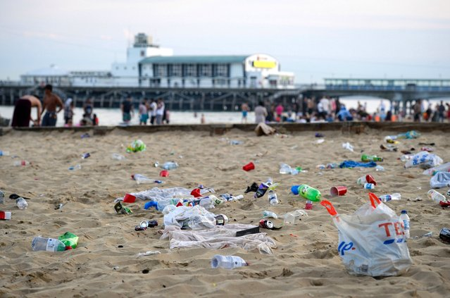 Rubbish litters the beach after many visitors leave on June 25, 2020 in Bournemouth, United Kingdom. A major incident was declared by the local council as thousands flocked to Bournemouth and the Dorset coast. The UK is experiencing a summer heatwave, with temperatures in many parts of the country expected to rise above 30C and weather warnings in place for thunderstorms at the end of the week. (Photo by Finnbarr Webster/Getty Images)