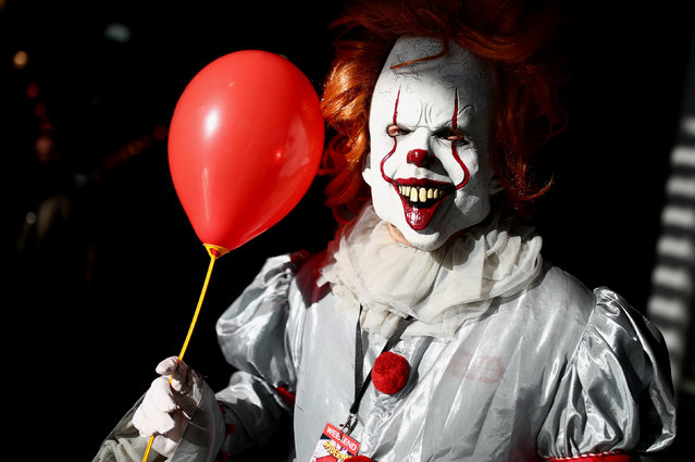 "A cosplayer costumed as Pennywise the clown from the horror movie ""It"" poses during the Vienna Comic Con, Austria, November 17, 2018. (Photo by Lisi Niesner/Reuters)"