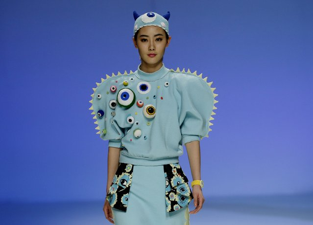 "A model shows a creation at ""BIFT (Beijing Institute of Fashion Technology)-ELLASSAY"" scholarship awarding ceremony during China Fashion Week in Beijing, March 26, 2015. (Photo by Kim Kyung-Hoon/Reuters)"