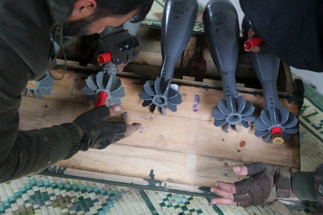 Free Syrian Army fighters prepare shells before firing them towards Islamic State fighters in the northern Aleppo countryside, Syria, January 18, 2016. (Photo by Abdelrahmin Ismail/Reuters)